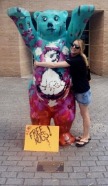 Stephanie Hugging A Bear Statue