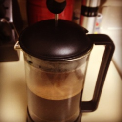 Photo of depressing plunger of a french press pot