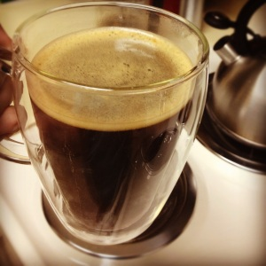 Photo of coffee in a clear glass mug